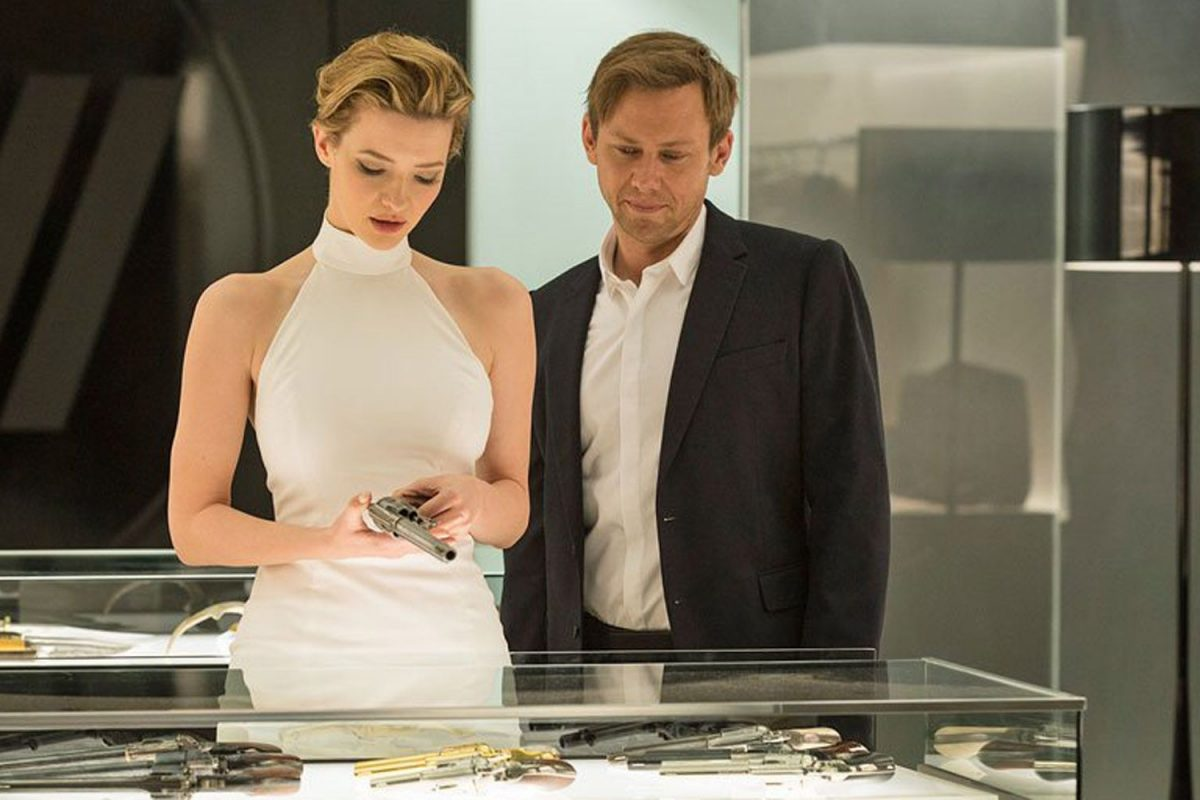 Talulah Riley, Jimmi Simpson standing in front of a table