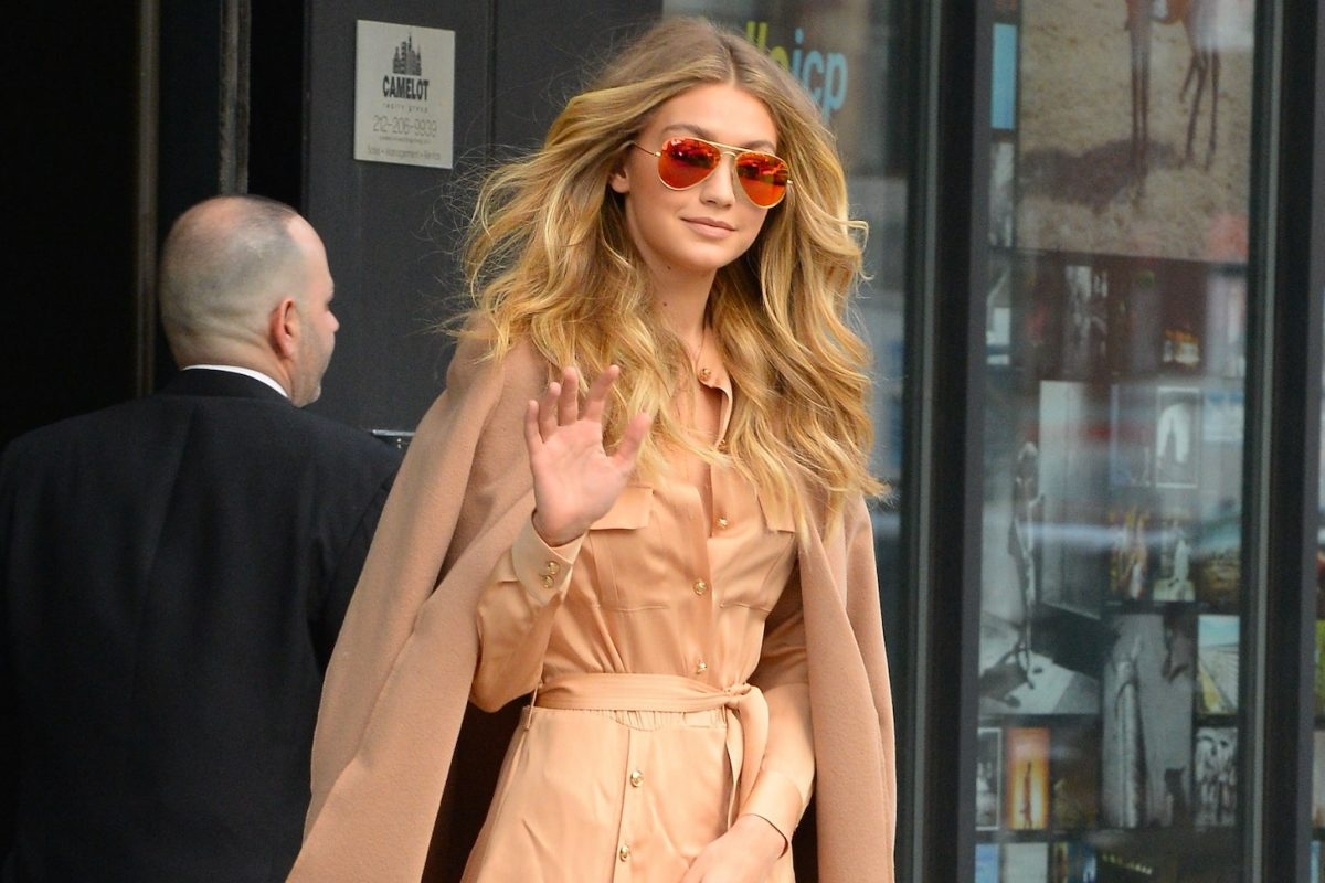 Gigi Hadid standing in front of a store