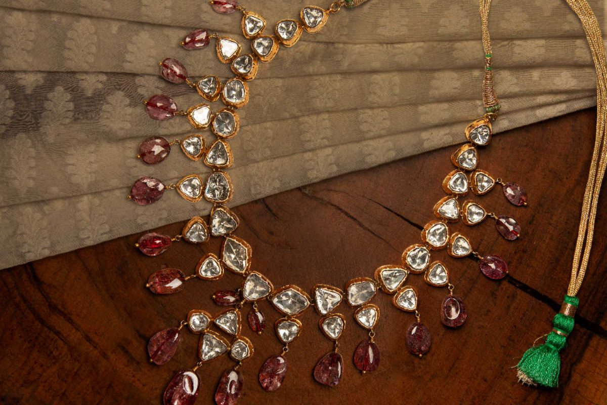 A necklace on a wooden table