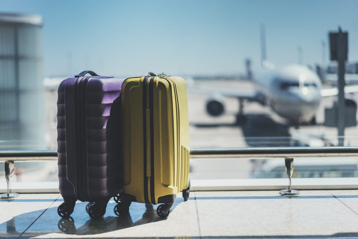 A plane sitting on top of a suitcase