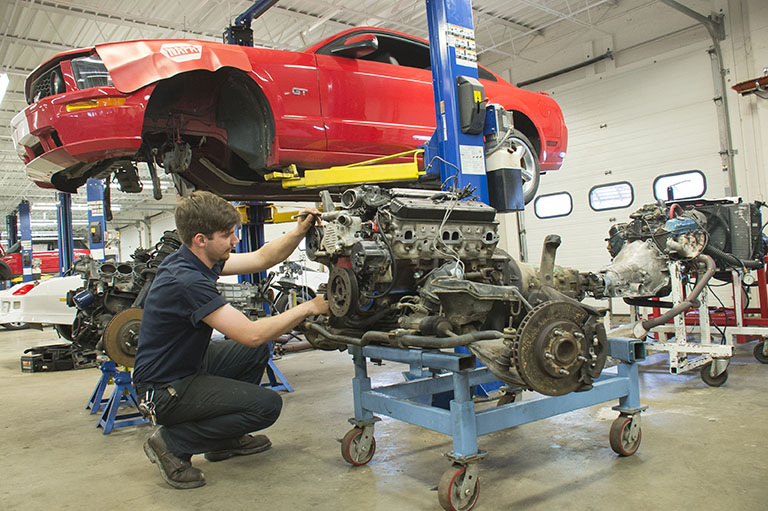 A person repairing the car in garage